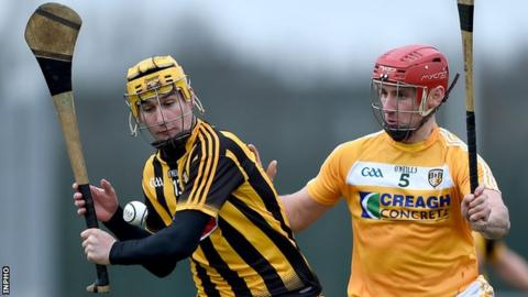Richie Leahy attempts to get in a shot despite the efforts of Antrim's Simon McCrory