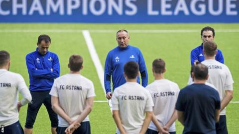 Astana coach Stanimir Stoilov (centre) addresses his players during training