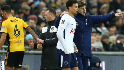 Mauricio Pochettino gives instructions to substitute Dele Alli as opposite number Mike Flynn takes off Ben White at Wembley