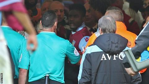 Micah Richards (centre) in the tunnel at the end of the match between Aston Villa and Swansea