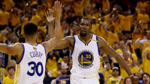 Stephen Curry and Kevin Durant celebrate