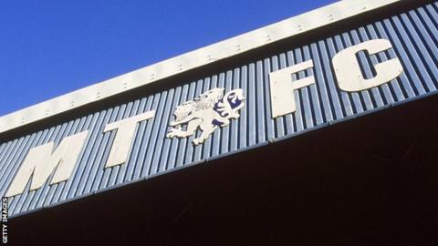 Macclesfield Town's FA Cup tie against Kingstonian on Sunday is at risk after the club's players went on strike