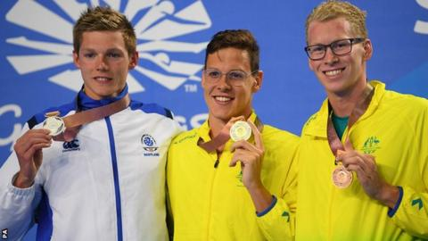 Duncan Scott (left) shows off his silver medal as he shares the podium with Mitch Larkin and Clyde Lewis
