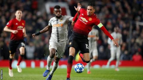 Jean-Pierre Nsame in action for Young Boys Bern against Manchester United's Chris Smalling in the Uefa Champions League