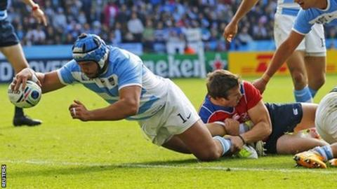 Argentina's Lucas Noguera scores a try against Namibia
