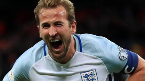 Harry Kane celebrates scoring for England