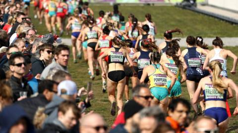 Aarhus, Denmark, 30 March: Spectators watch on at the start of the women's senior race at the IAAF World Athletics Cross Country Championships.