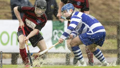 Oban Camanachd and Newtonmore players splash about on An Aird pitch