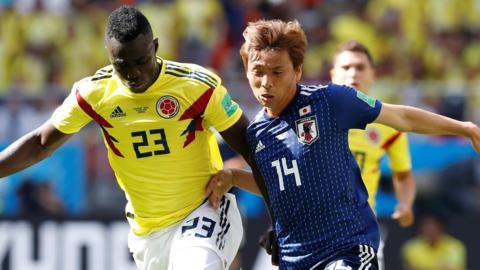 Colombia's Davinson Sanchez challenges Japan's Takashi Inui