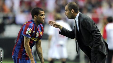 Pep Guardiola (right) with Daniel Alves