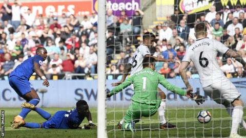 Kyle Naughton scores an own goal just before half-time