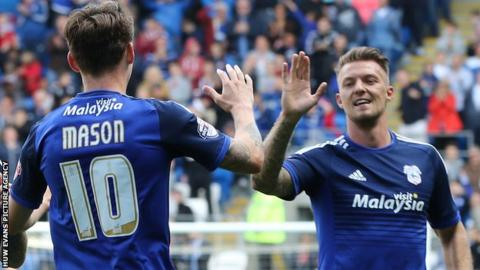 Joe Mason and Anthony Pilkington celebrate Cardiff's in over Huddersfield