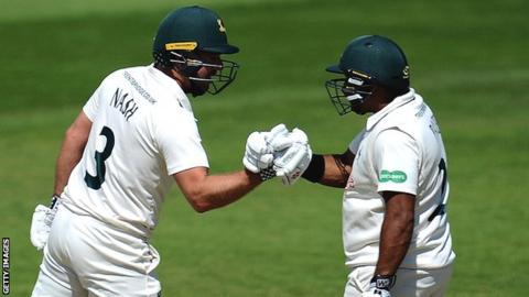 Nottinghamshire batsmen Chris Nash and Samit Patel touch gloves