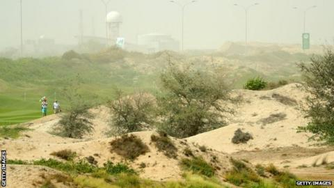 Al Mouj Golf in Muscat, Oman with dunes obscured by blowing sand