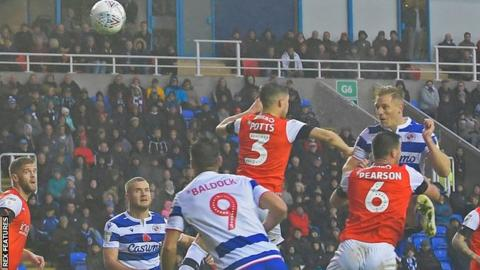 Michael Morrison heads Reading into a 1-0 lead against Luton