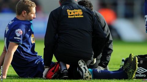 Hull captain Michael Dawson receives treatment against Bristol City