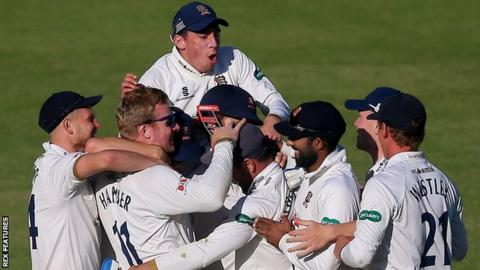 Essex celebrate after Simon Harmer takes the match-winning wicket
