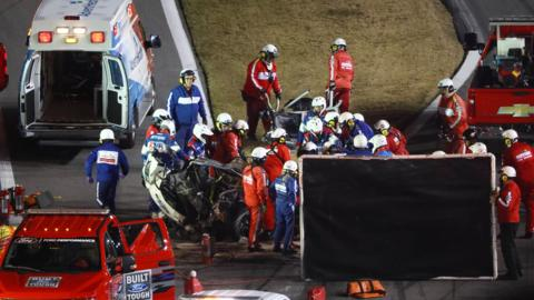 Emergency services tend to Ryan Newman's car after the driver crashed at the Daytona 500