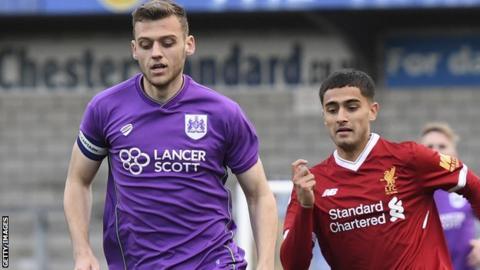 Aden Baldwin (left) in action for Bristol City Under-23s