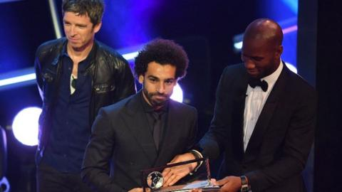 Noel Gallagher (left), Mo Salah and Didier Drogba