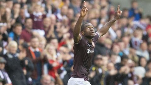 Uche Ikpeazu celebrates scoring for Hearts