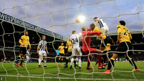 Jonny Evans heads in West Brom's opener against Watford