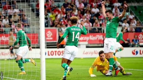 Kevin Long (left) and Callum Robinson (centre) celebrate Aiden O'Brien's goal in Wroclaw