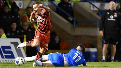 Walsall winger Kieron Morris is fouled by Gillingham midfielder Billy Knott in Tuesday's 1-1 draw at the Priestfield Stadium