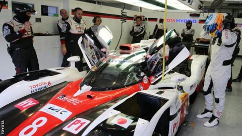 Fernando Alonso prepares to get into Toyota's LMP1 car