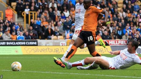 Benik Afobe doubled Wolves' lead