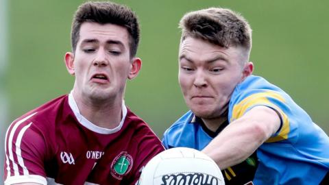 Colm Byrne of St. Mary's disputes possession with UCD's Conor McCarthy during the Sigerson showdown