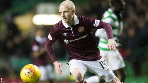 Steven Naismith in action for Hearts against Celtic