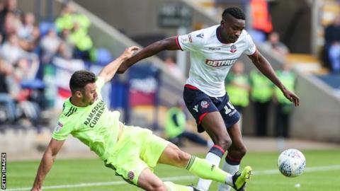 Bolton Wanderers' Sammy Ameobi competing with Sheffield United's Enda Stevens