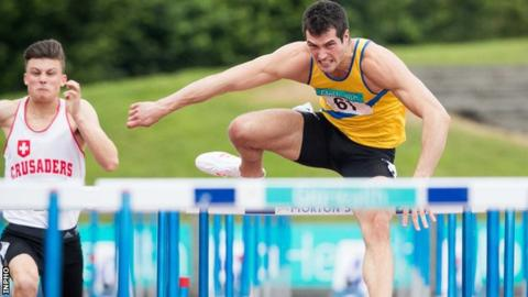 Ben Reynolds clears a hurdles on his way to victory at Santry on Sunday