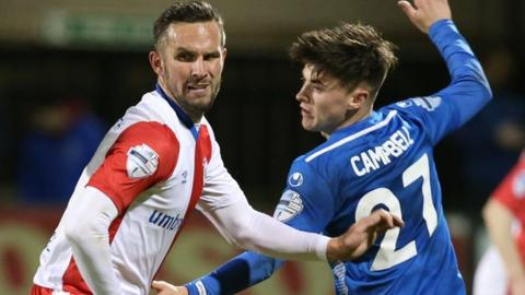 Linfield reached the last eight with a 4-0 win over Dungannon Swifts