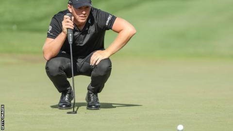 Matt Wallace lines up a putt on the fifth hole during the third round of the Players Championship