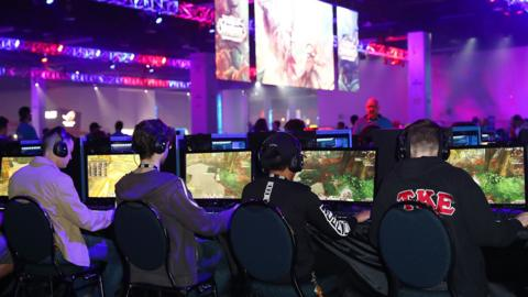 Esports contestants playing video games at a convention