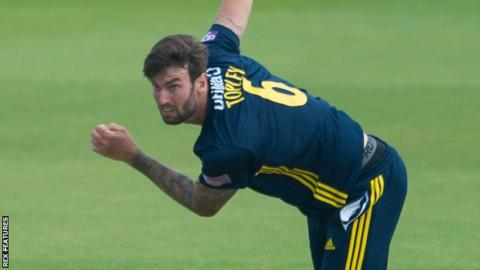 Reece Topley bowls for Hampshire