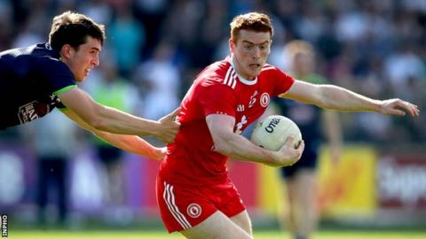 Kildare's Mark Dempsey and Peter Harte of Tyrone