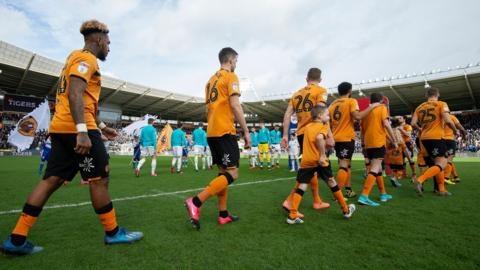 Players walk out before a Championship match