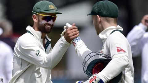 Nathan Lyon celebrates with Peter Nevill