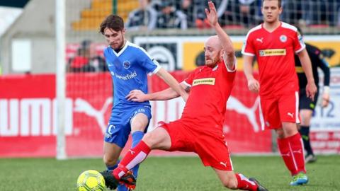 Ryan Catney battles with Ballinamallard's Ryan Mayse in November 2016
