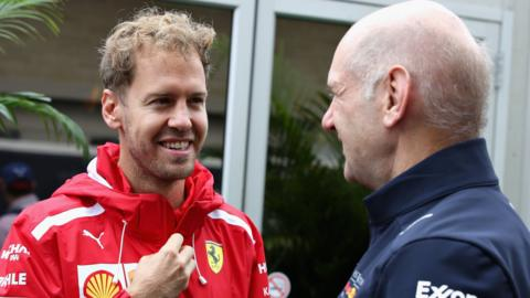 Ferrari's Sebastian Vettel talks with Adrian Newey, the Chief Technical Officer of Red Bull Racing