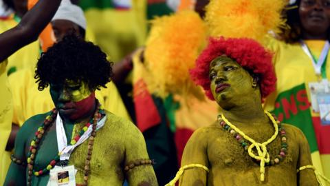 Ismailia, Egypt, 29 June: Benin fans painted in their country's colours struggle to get excited during their 0-0 draw against Guinea-Bissau in a Group F encounter at the Africa Cup of Nations. (Ozan Kose/AFP/Getty Images)