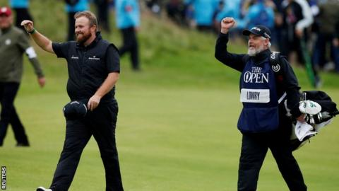 Shane Lowry and his caddie Brian 'Bo' Martin celebrate as they walk to the 18th green on Sunday