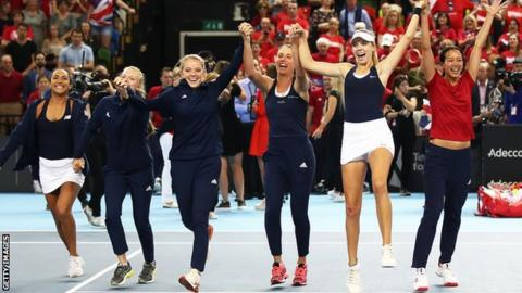 Team GB Katie Boulter, Katie Swan, Johanna Konta, Harriet Dart, Heather Watson and captain Anne Keothavong of Great Britain after defeating Kazakhstan during the Fed Cup World Group II Play-Off match between Great Britain and Kazakhstan at Copper Box Arena on April 21, 2019 in London, England.