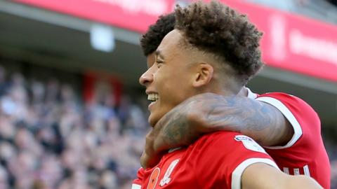 Marcus Tavernier celebrates a goal with a Middlesbrough team-mate in front of fans
