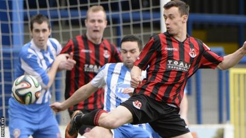 Coleraine midfielder Neil McCafferty challenges Crusaders winger Paul Heatley