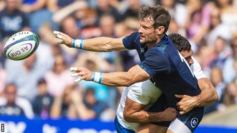 Finn Russell Scotland's Peter Horne is tackled by France's Charles Ollivon