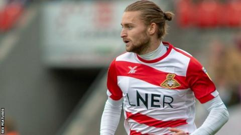 Alfie May in action for Doncaster Rovers